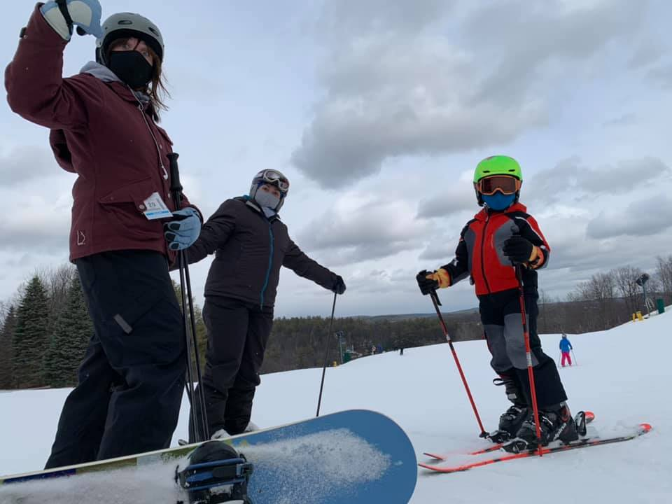 Skiing in New Hampshire - three people on skis