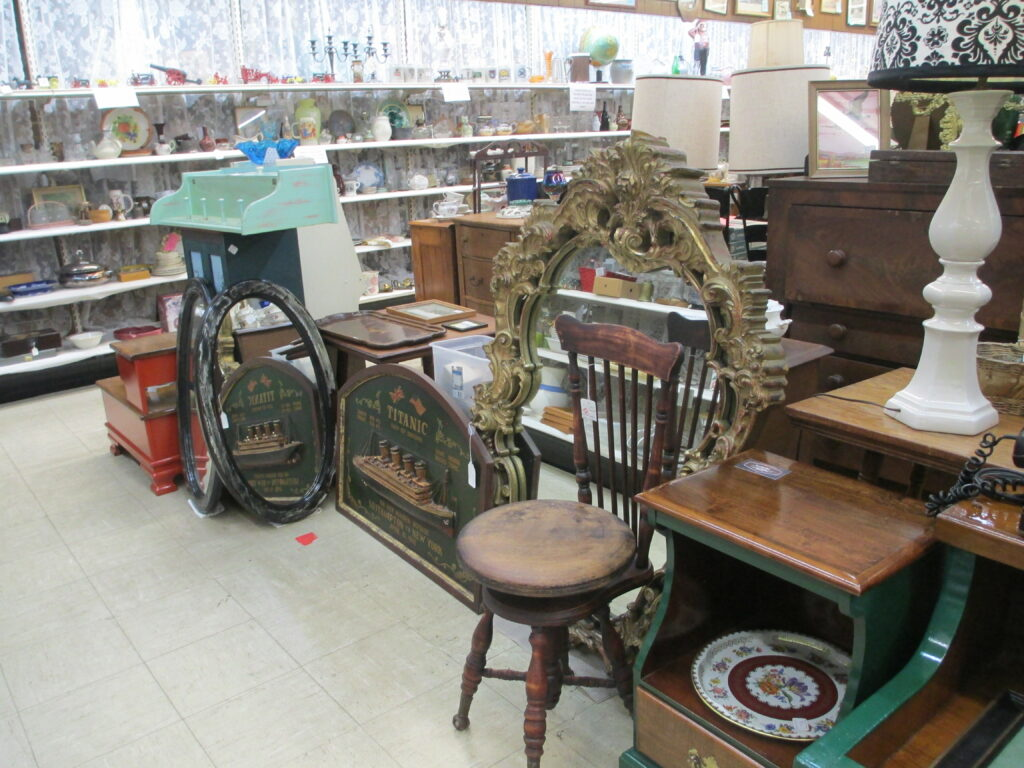 A sampling of the inventory at Antiques Mall of New England: chair, lamp, glassware, and more