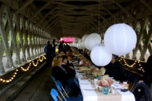 Dinner in the Ashuelot Bridge, family-style beneath paper lanterns and fairy lights