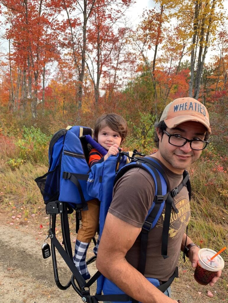 Autumn hike with a baby in the back carrier