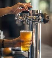 Beer tap fills a pint glass