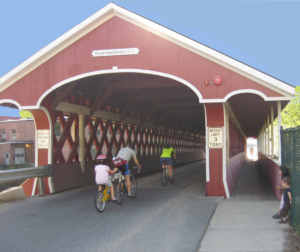 Cyclists going through the Thompson Covered Bridge in West Swanzey