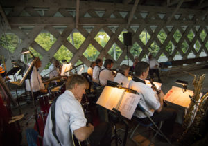Band playing at the annual dinner in the Ashuelot Covered Bridge, photo by Beth Pelton of Eight Cattails Imagery