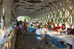 Annual dinner in the Ashuelot Covered Bridge, photo by Beth Pelton of Eight Cattails Imagery