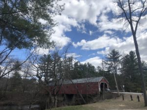 Carlton Covered Bridge with beautiful blue sky with cumulus clouds (Swanzey, New Hampshire)