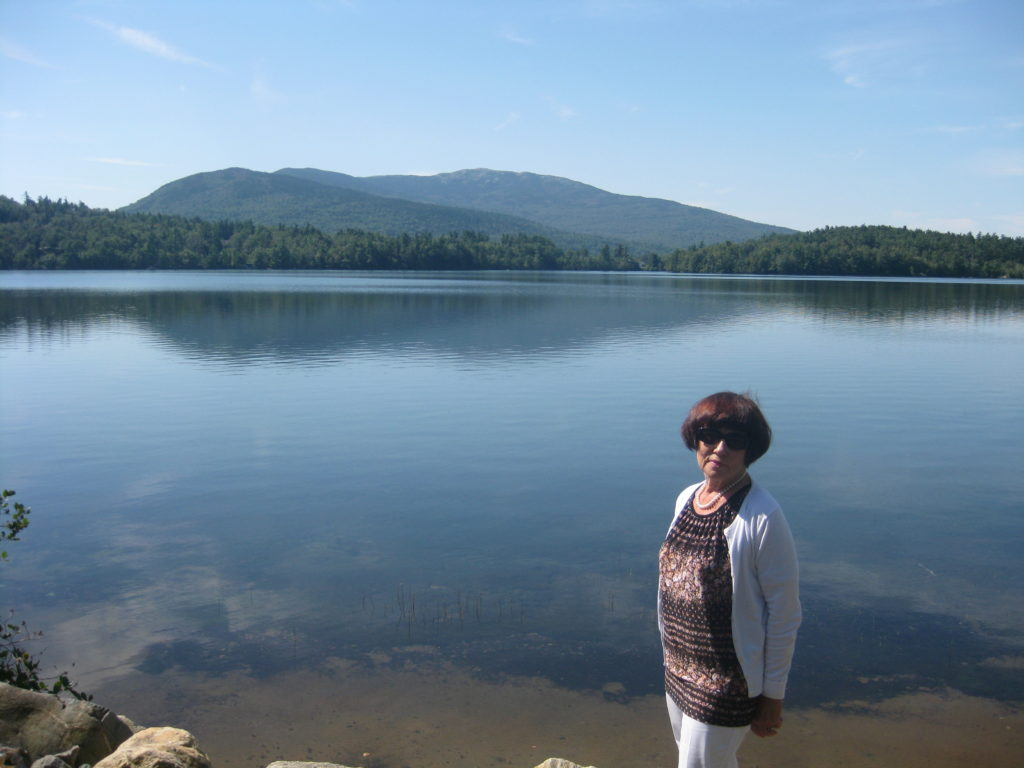 Woman at Dublin Lake, Dublin, NH with Mt. Monadnock in background