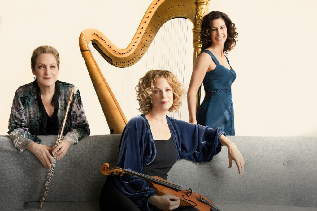 Three female musicians, with musical instruments