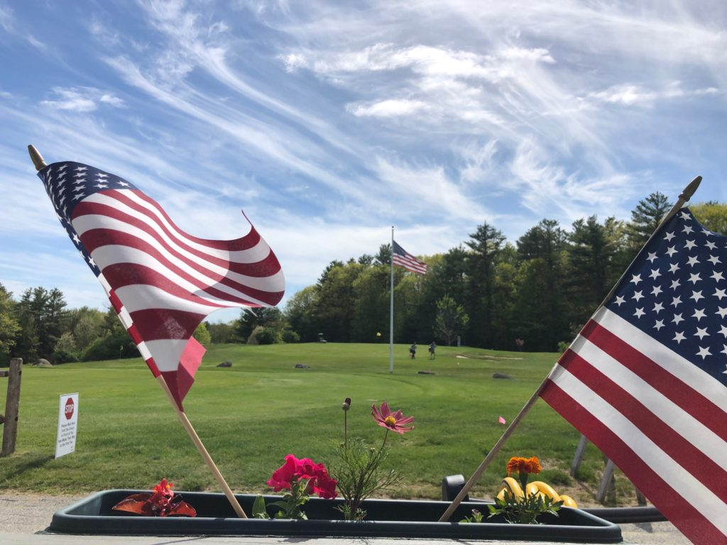 American flags on a golf course