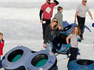 Kids and adults with snow tubes