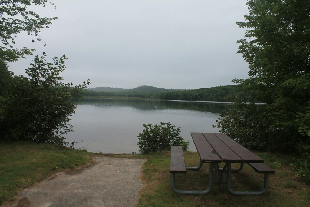Picnic table and lake at Greenfield State Park