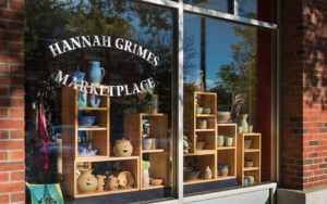 Pottery and wares displayed for sael through store front window