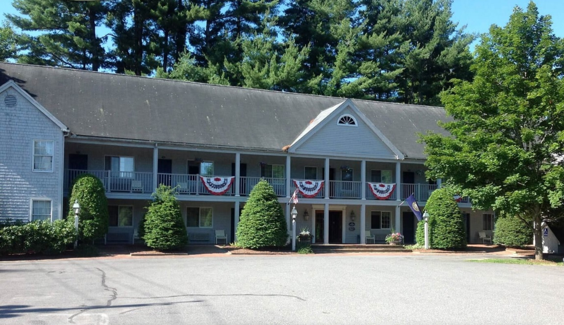 Front view of the Jack Daniels Motor Inn with shrubs and trees