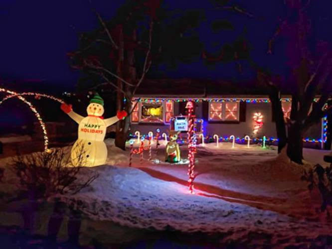 House lit up for Christmas with illuminated snowman
