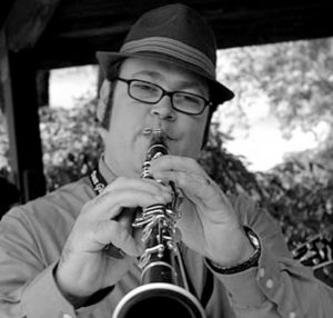 Jason Thomas Koerber playing the clarinet