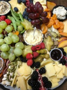 CC&D Kitchen's Charcuterie Plate with cheese, fresh fruit, dips, vegetables, and more