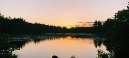Beautiful sunset at Pratt Pond in Mason, with two kayaks