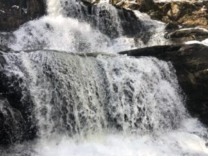 Close-up photo of waterfalls with a rocky background