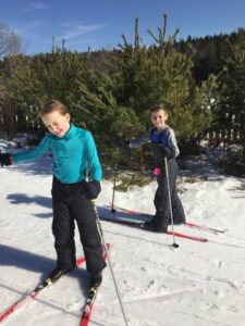 Young boys cross-country skiing
