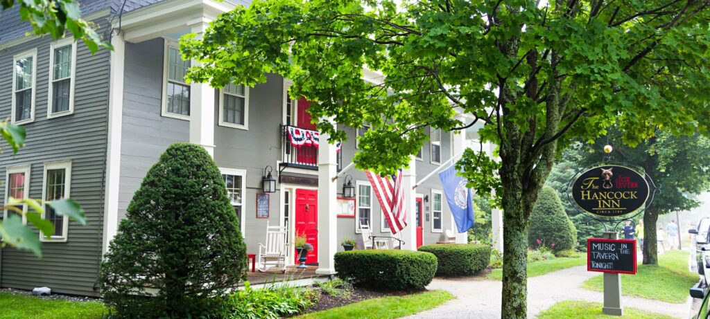 Picturesque Hancock Inn adorned with two flags