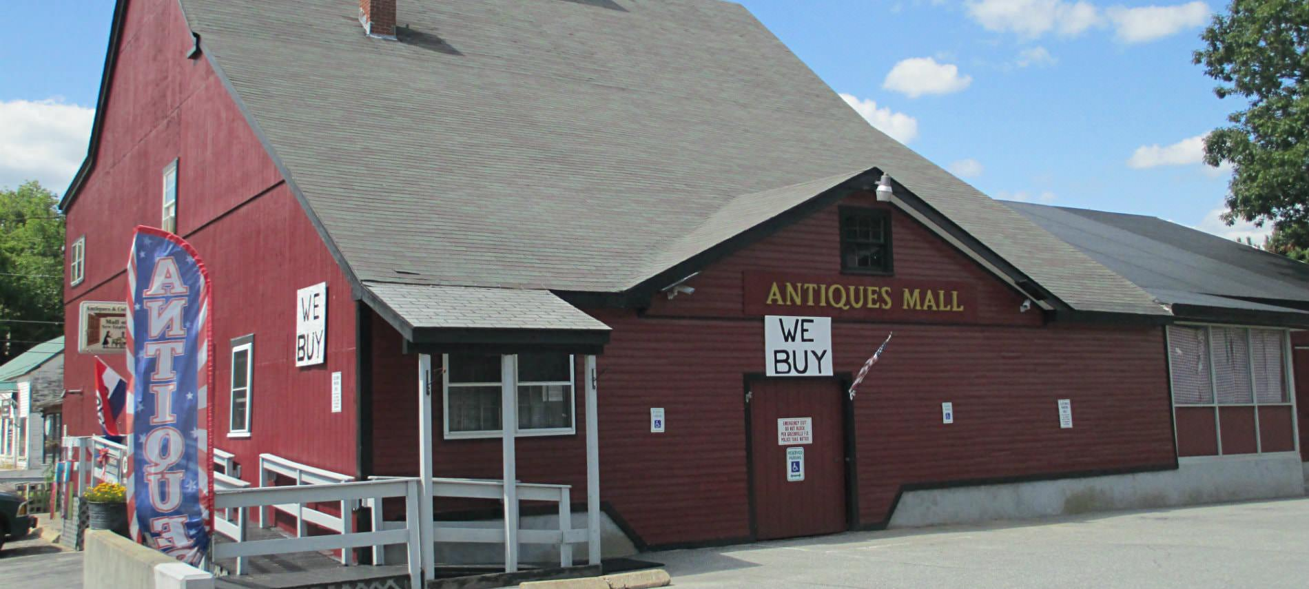 Red barn Antiques Mall with parking lot