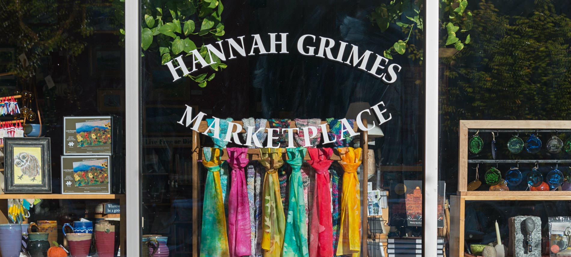 Hannah Grimes Marketplace window front with scarves, mugs, and items for sale