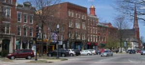 Downtown Chamber of Commerce, row of multi-height brick buildings lined with trees