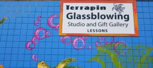Front of Terrapin Glassblowing Studio and Gift Gallery Lesson painted blue with sea turtle