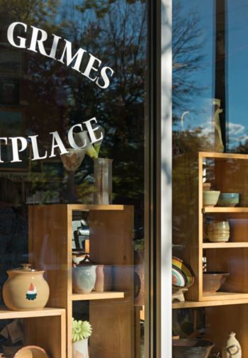 Hannah Grimes Marketplace window front with wood cubicles filled with items for sale