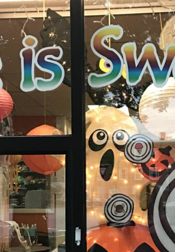 Life is Sweet store front window decorated for halloween