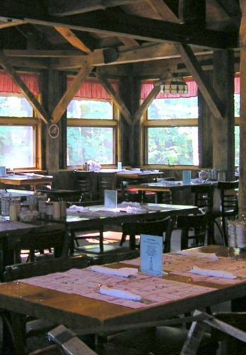 Inside of Parkers Maple Barn - wood framed room with lots of tables and chairs