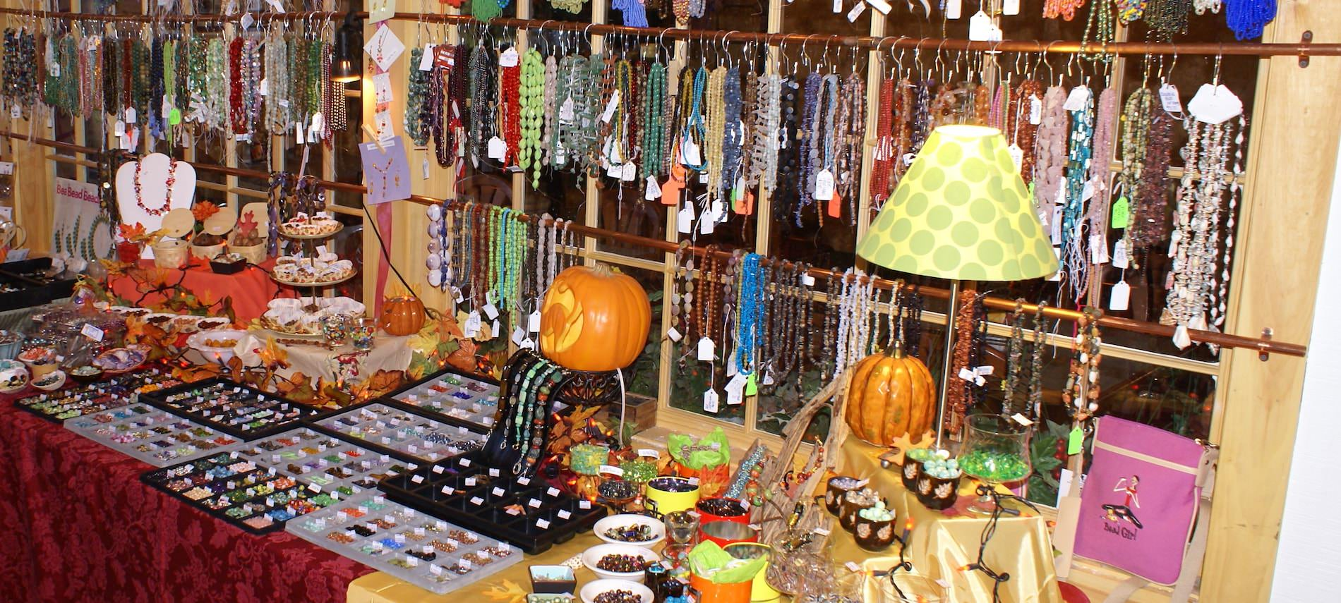 Table display inside a store full of necklaces, bracelets, rings, and more